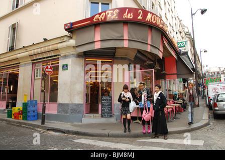 Japanese tourists at Cafe des 2 Moulins famous for Amelie film Paris France - Stock Photo