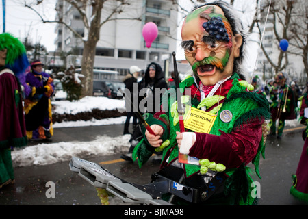 Guggenmusig Bacchus-Musig group dressed to the theme of Bacchus, the God of Wine, during the carnival procession - Stock Photo