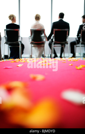 Civil wedding, bride and groom, flower petals strewn across the floor - Stock Photo