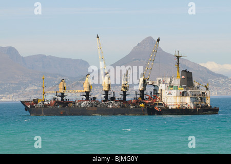 The Seli 1 a small bulk carrier lays aground in Table Bay off Cape Town South Africa. Close to the beach at Bloubergstrand - Stock Photo