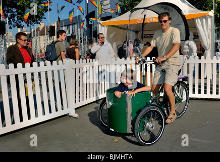 Paris, France, People Visiting Alternative Transportation Show, 'Fete des Transport', Father and Son Riding Bicycle - Stock Photo