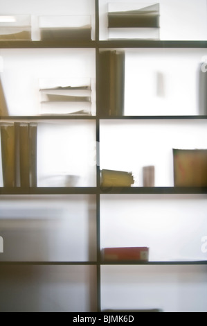 Shelves with trays and file folders behind a glass wall - Stock Photo