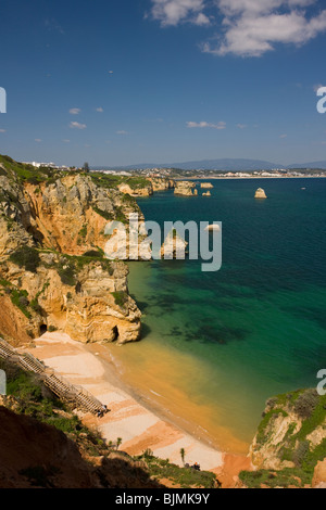 Eroding cliffs, stacks and islets at Ponta da Piedade, near Lagos, Algarve, Portugal. - Stock Photo