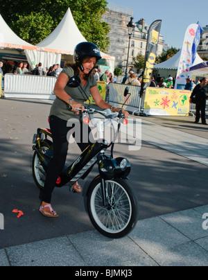 Paris, France, People Visiting Alternative Transportation Show, ('Fete des Transport'), Woman Riding Electric Bicycle - Stock Photo