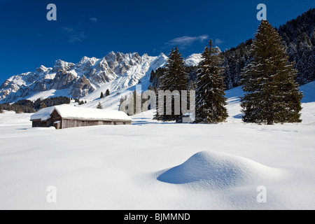 Mountain hut in the Appenzell region with a view towards the Alpstein Mountains, Switzerland, Europe - Stock Photo