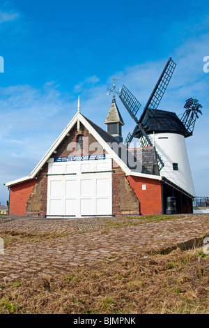 Lifeboat house and windmill at Lytham St Annes, Lancashire. - Stock Photo