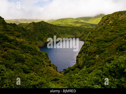 A caldeira, or crater lake, on the island of Flores, in the Azores - Stock Photo