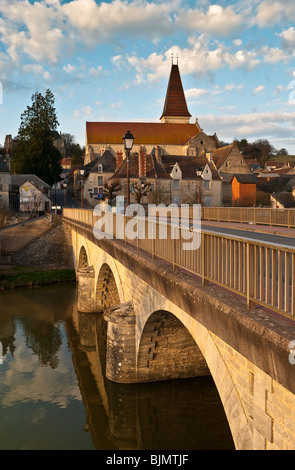 Preuilly-sur-Claise abbey church and river bridge - France. - Stock Photo