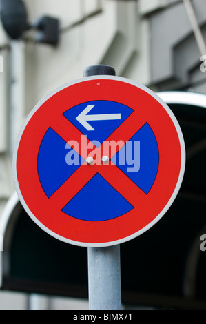 No stopping (start) This sign marks the beginning of a no stopping area Sign Berlin Germany Europe - Stock Photo