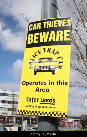 A Police Trap Car warning sign in a U.K. city. - Stock Photo