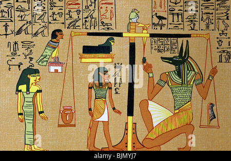 Anubis, jackal-headed god of the dead, weighs the heart of the scribe Ani, against the feather of truth to decide - Stock Photo