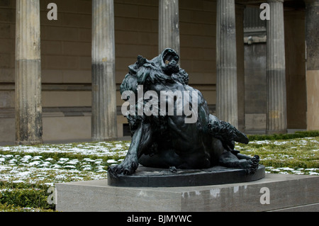 Berlin German statue of a man fighting with a beast outside Neues museum - Stock Photo