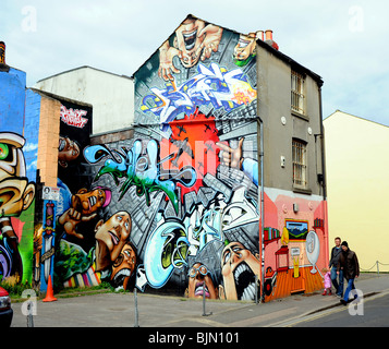Buildings covered in approved graffiti art in the North Laine area of Brighton city centre UK 2010  ( this area - Stock Photo