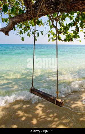 Swing on tropical sea beach - Stock Photo