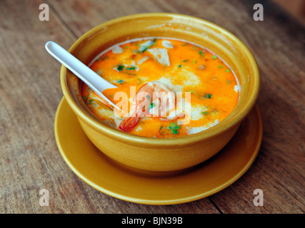 Bowl of spicy Thai Tom Yum Soup - Stock Photo