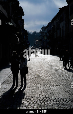 Piedmont, Italy, a street scene with people in silhouette - Stock Photo
