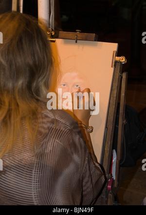 Street artist penciling a caricature on the Halkidiki resort of Hanioti - Stock Photo
