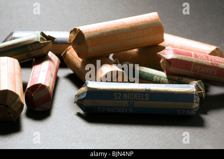 US Coins in Wrappers.  $10 Quarters, $5 Dimes, $2 Nickels, 50¢ Pennies. - Stock Photo