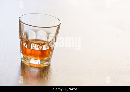 whiskey glass on wooden counter - Stock Photo