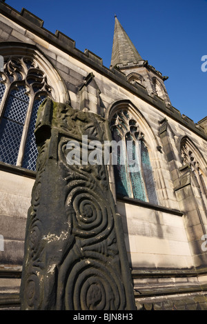 Saxon cross in the churchyard at All Saints Church, Bakewell, Derbyshire. - Stock Photo