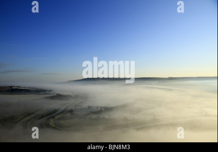 Looking west across the mist shrouded Cuckmere Valley near Alfriston, East Sussex, England. Stock Photo