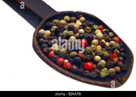 Color peppercorns on wooden spoon - Stock Photo