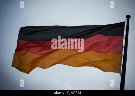 The German flag flying in the air Berlin Germany Europe - Stock Photo