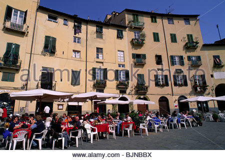 lucca, tuscany, italy, cafe in piazza del mercato (built on the foundations of the roman amphitheatre) - Stock Photo