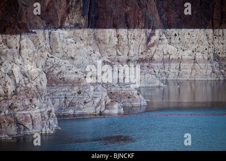 Marks along the canyon walls of Lake Mead at the Hoover Dam show the low water level due to over use of water resources - Stock Photo