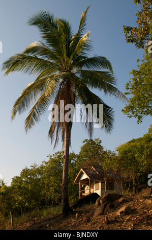 Shack on the side of a cliff in Koh Phangan Thailand - Stock Photo