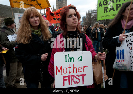 March & protest in London for Mothers struggling due to abuse. war,  immigration,  poverty,  overwork,  underpay - Stock Photo