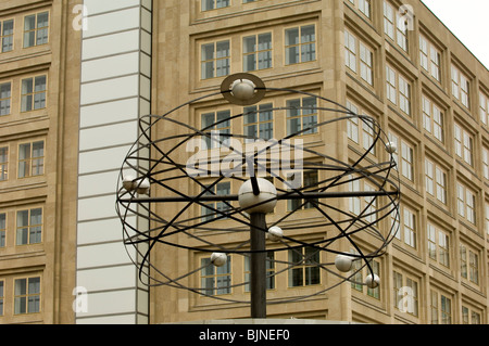 The Weltzeituhr world time clock in Alexanderplatz square Berlin Mitte Germany - Stock Photo