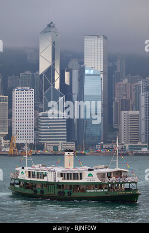 Star Ferry sailing in Hong Kong Harbour between Central and Tsim Sha Tsui - Stock Photo