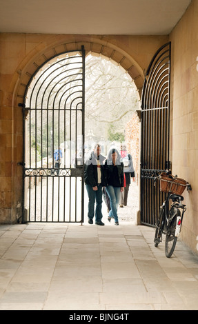 University students walking;  Old Court, Clare College Cambridge University, UK - concept of Cambridge University entrance