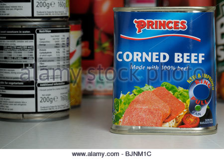 Close up of a tin of Princes Corned Beef in a store cupboard, England UK - Stock Photo