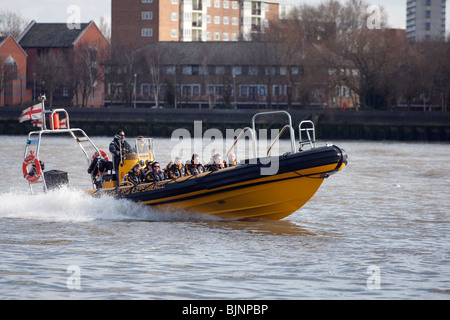 Tourists enjoying a trip along the River Thames, London in a RIB boat. - Stock Photo
