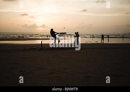 People playing cricket on mumbai beach