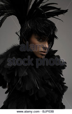 A woman dressed in a feather outfit - Stock Photo
