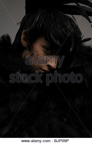 A woman wearing a feather headdress - Stock Photo