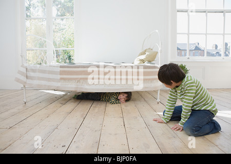 Boys playing hide and seek - Stock Photo