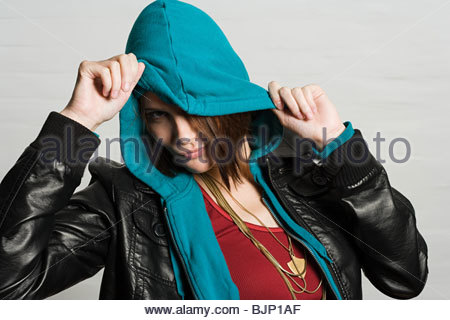 Young woman in hooded top - Stock Photo