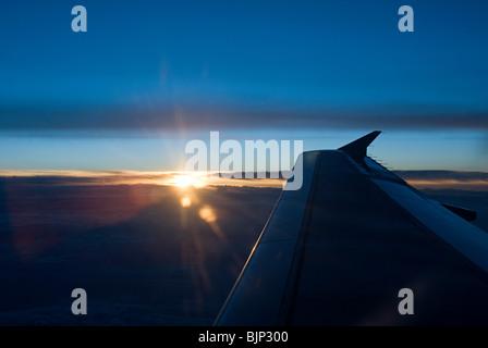 Sunset and aeroplane wing - Stock Photo
