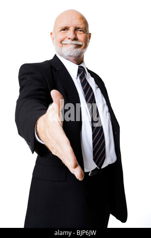 Portrait of businessman with outstretched hand - Stock Photo