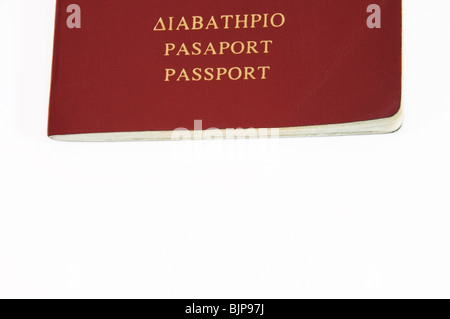 Cypriot Greek passport with bilingual writing on white background, CYP - Stock Photo