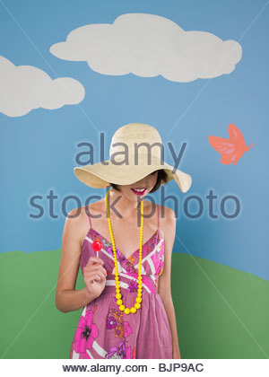 Young woman in sun hat - Stock Photo