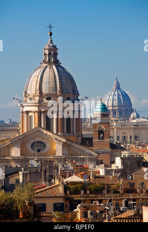 San Carlo al Corso and Saint Peter's Cupolas, Rome - Stock Photo
