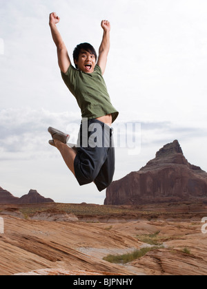 Person leaping in the air - Stock Photo