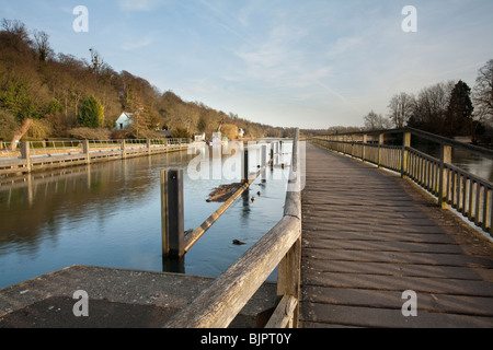 Looking along the wooden footbridge over the River Thames from Marsh Lock near Henley on Thames, Uk - Stock Photo