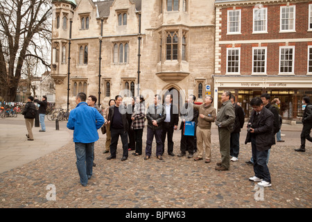 Tourists at the main entrance to Trinity College, on Trinity Street, Cambridge University, UK - Stock Photo