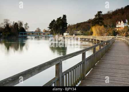 Looking along the wooden footbridge over the River Thames towards Marsh Lock near Henley on Thames in Oxfordshire, - Stock Photo